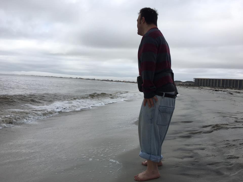 Elisha contemplating at the beach