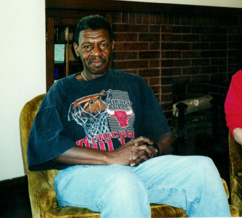Elbert pictured in the living room of Angel House on move-in day in 2000