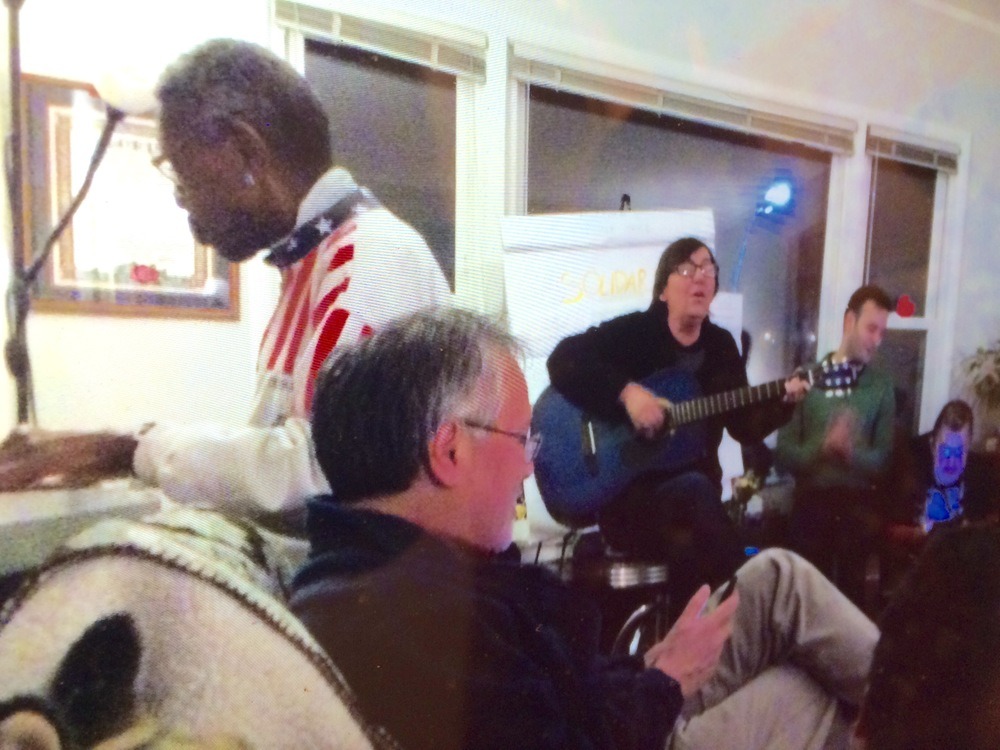 Laurie and Elbert lead the singing at L'Arche Chicago community night