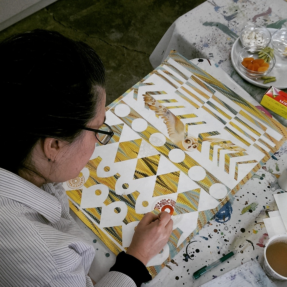 Liz works her magic on a marbled Native American-inspired geometric pattern.