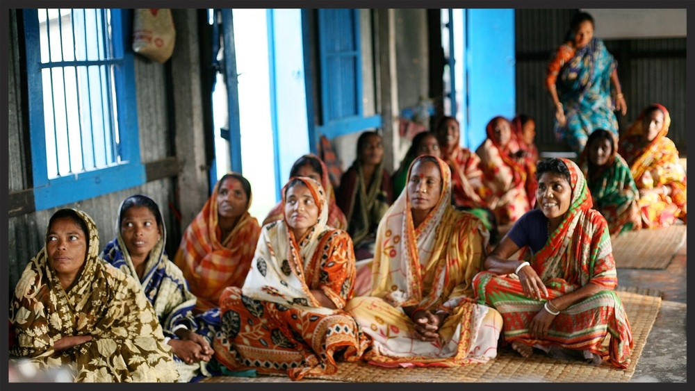 A group of women gather at an artisan workshop in Bangladesh.