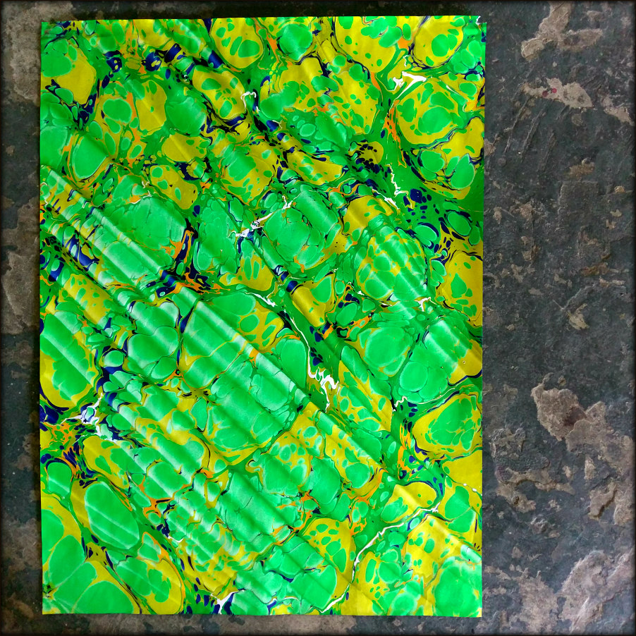 SpanishMarbleBrightGreenYellowBlueFullFramed.jpg