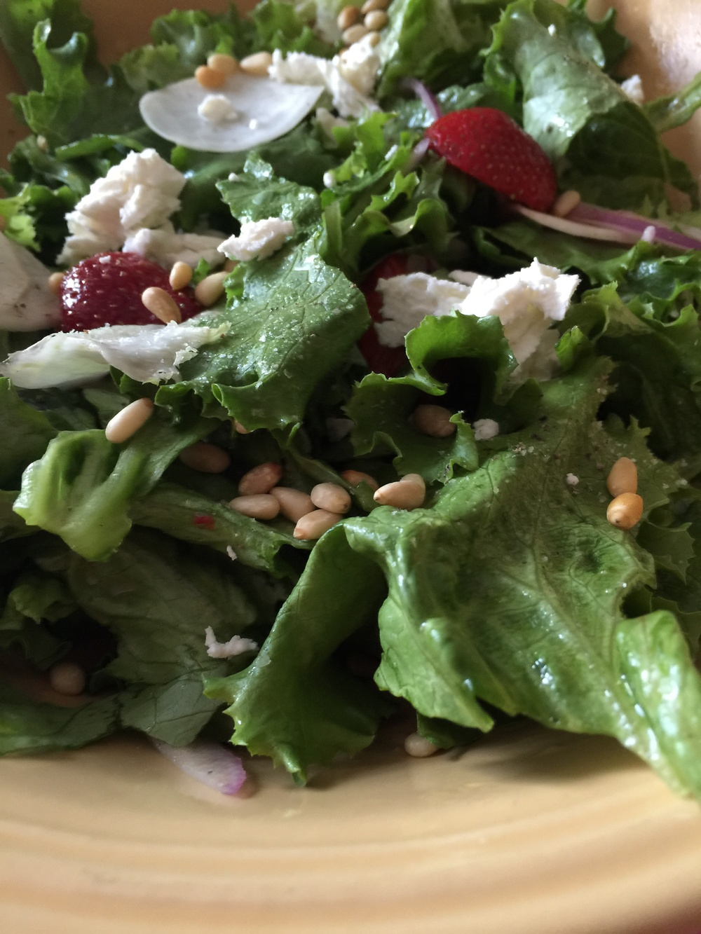 Salad with Curly leaflettuce, Hakurei turnips, strawberries, red onion, pine nuts, goat cheese