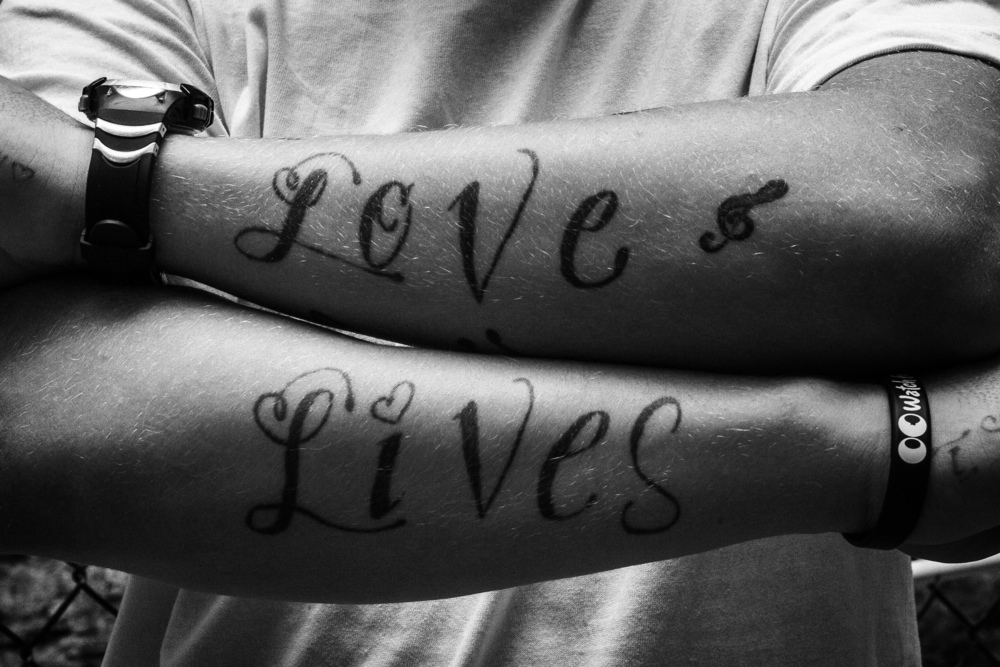 LOVE LIVES. LOVE LIVES Tattoo on Tim. Hunts Point, the Bronx, NYC. August 2012.