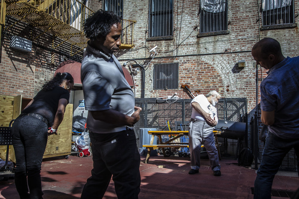 Sifu Rafael Rodriguez is a martial arts master and lifetime resident of East Harlem. He has been offering and teaching, non-drug based therapies for opioid addiction and other ailments since before he himself came back from Vietnam. Here he is leading a weekly workshop at NYHRE for clients and staff alike. Harlem, NYC 2016.