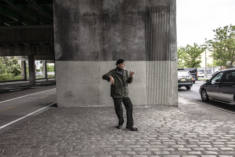 Walter Bosque practices tai-chi under the Bruckner Expressway where his childhood home once stood before it was tore down to make room for the highway. He has been a staunch leader and educator in the campaign to offer more holistic approach to opioid addiction since his days as a member of the Young Lords in the 1960's. South Bronx, NYC. 2016.