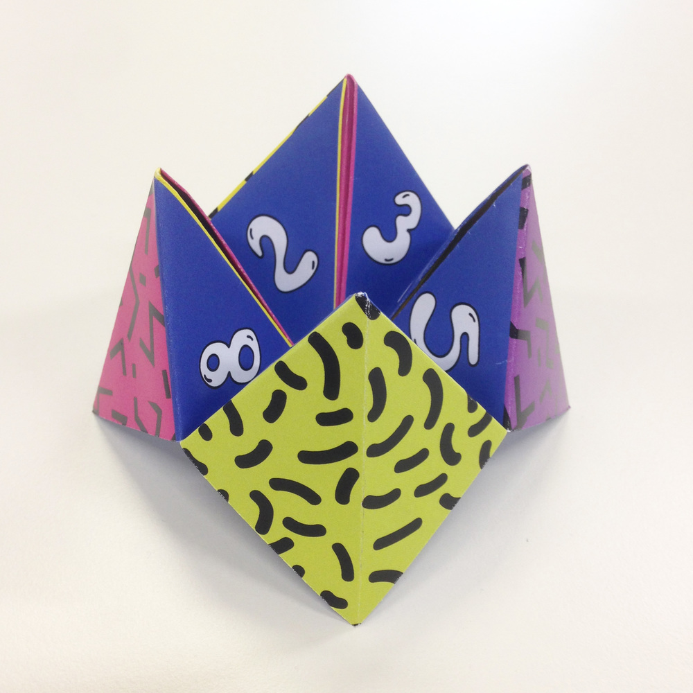 To build even more hype around the party, we made 200 nineties-style fortune tellers and left one on each employee's desk.