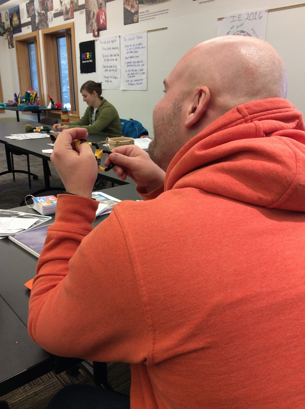 Fidgeting and listening at Sherman Lake YMCA's spring staff training.  Photo by Karen Christopherson.