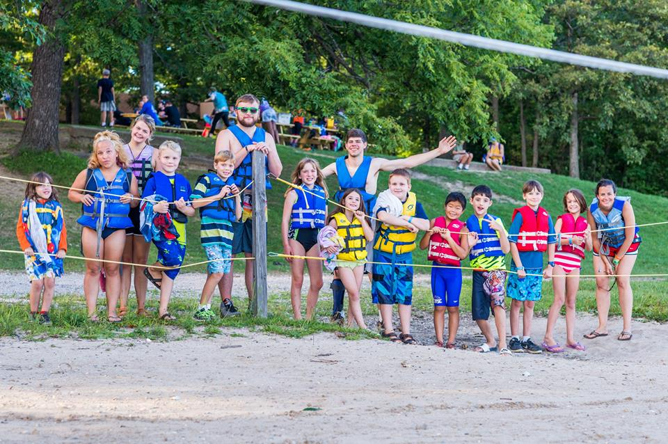 With my campers in the this summer getting ready for a pontoon boat ride at Camp Tall Tree (siblings program)!