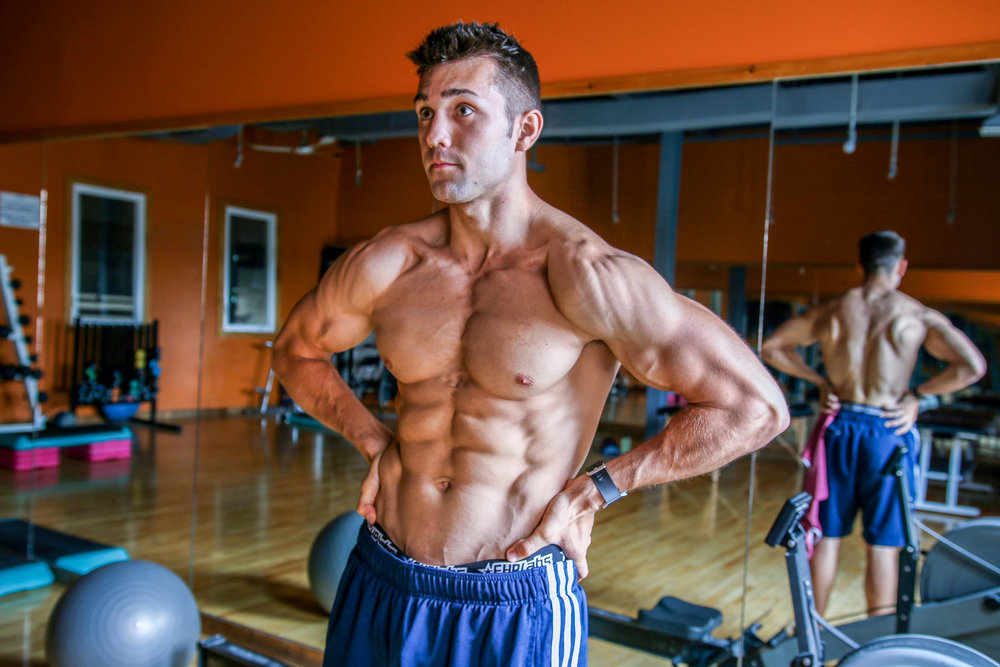 Natural coach and athlete Josh Wilkinson hitting a most muscular pose.