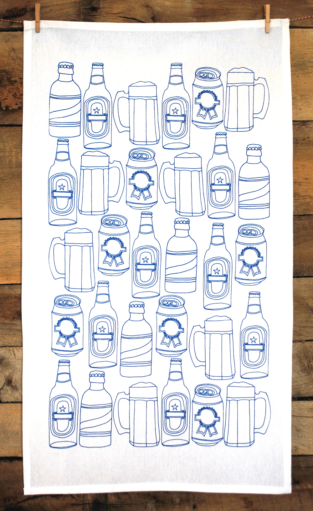 Screen printed tea towel featuring a hand-drawn beer pattern.