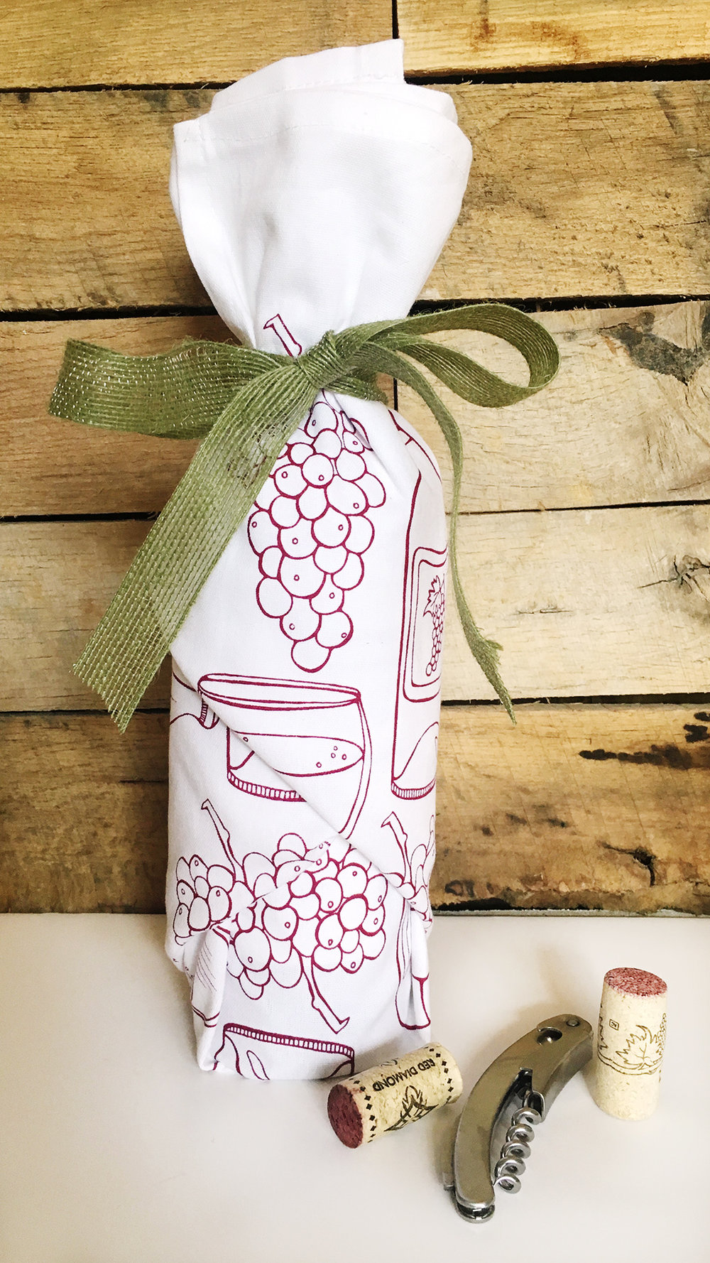 Wrap a bottle of wine in this wine tea towel and you've got an instant holiday hostess gift!