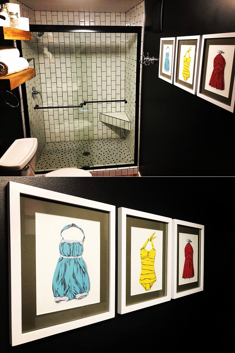 The original illustrations framed up and hanging in the bathroom at the Dam Near micro cabin.