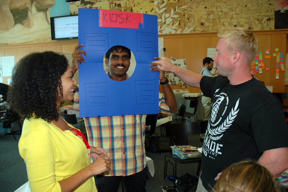 MBA students role playing an interactive information kiosk scenario