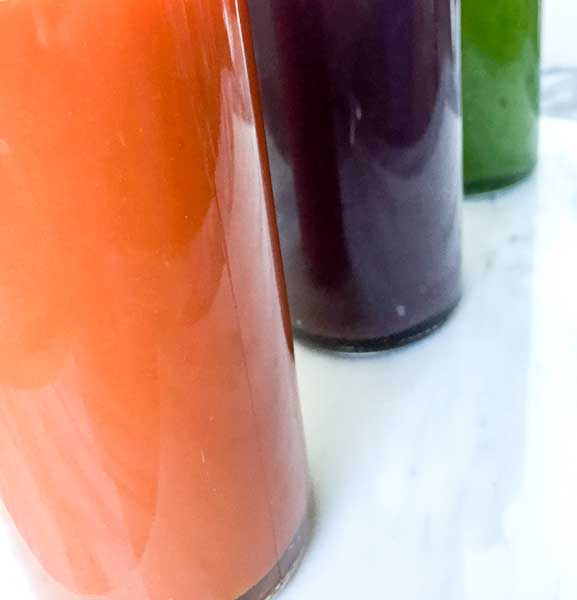 colorful slow juicer juice