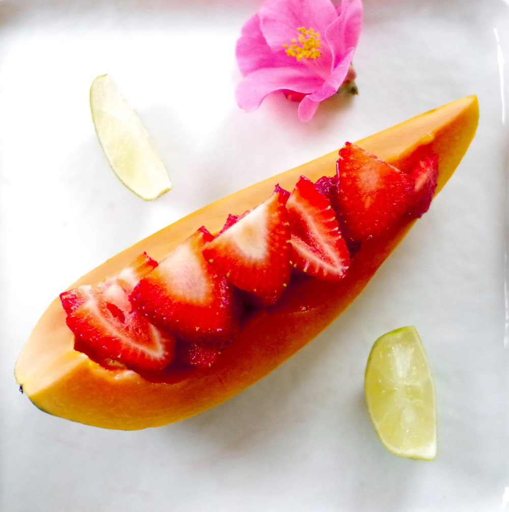 Strawberry papaya boat. The papaya's flavor comes alive when lime is squeezed over it.