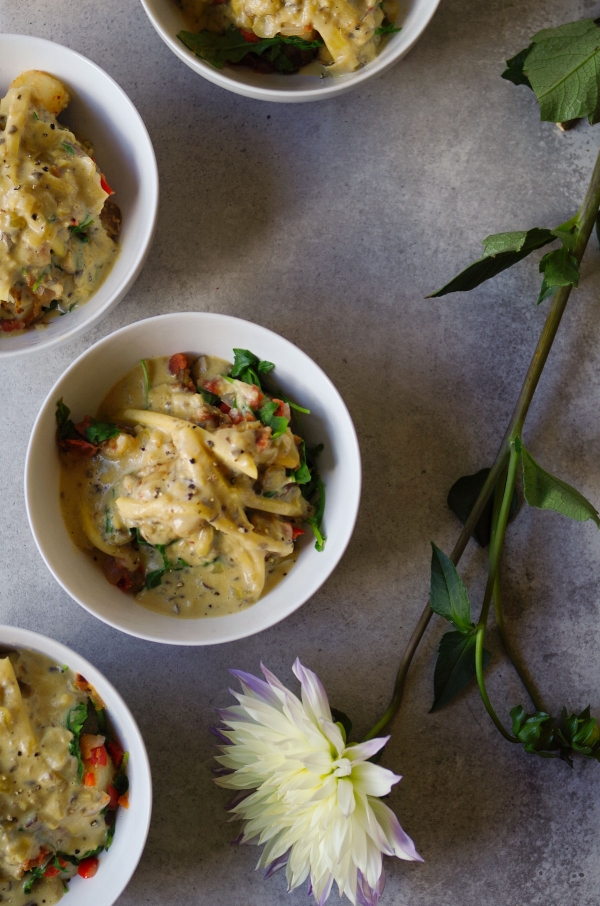 Bowls of Loaded Breakfast Potato, the ultimate comfort food. With vegan cheese.