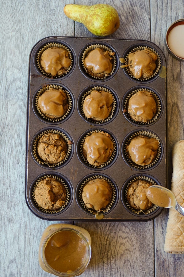 Silky Salted Caramel Sauce drizzled over Pear Spice Muffins.