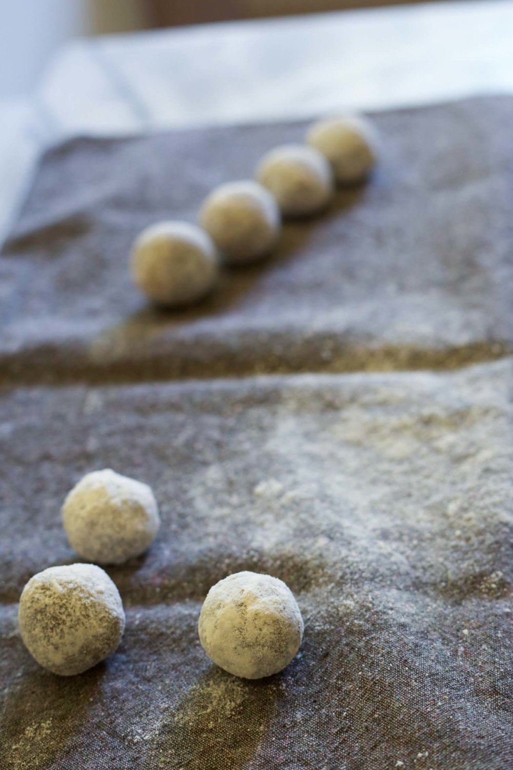 Roll the coconut flour-coated balls on a napkin or towel to create just a thin coat of flour. -