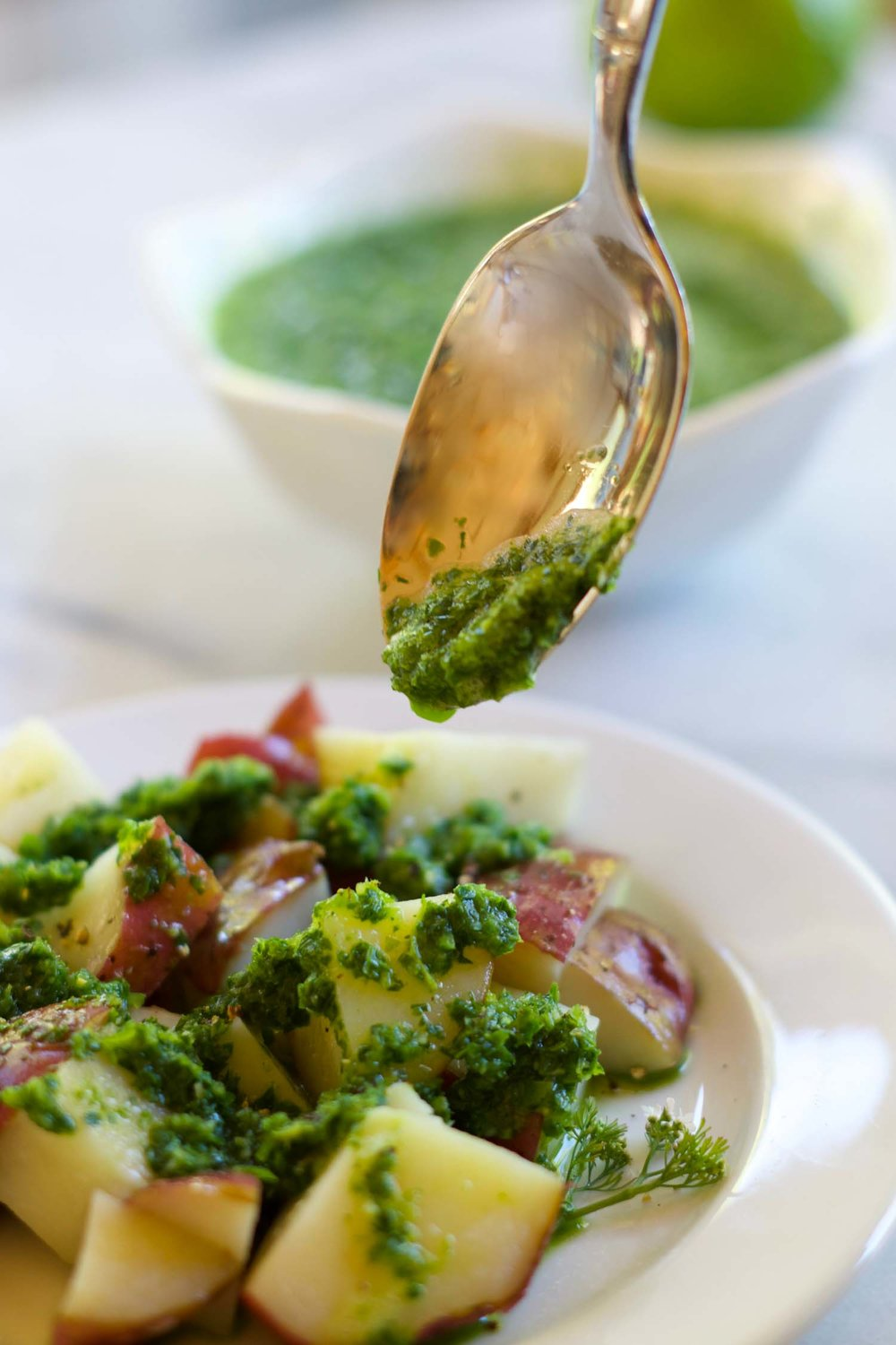 Chimichurri-ish over steamed potatoes, by Beautiful Ingredient