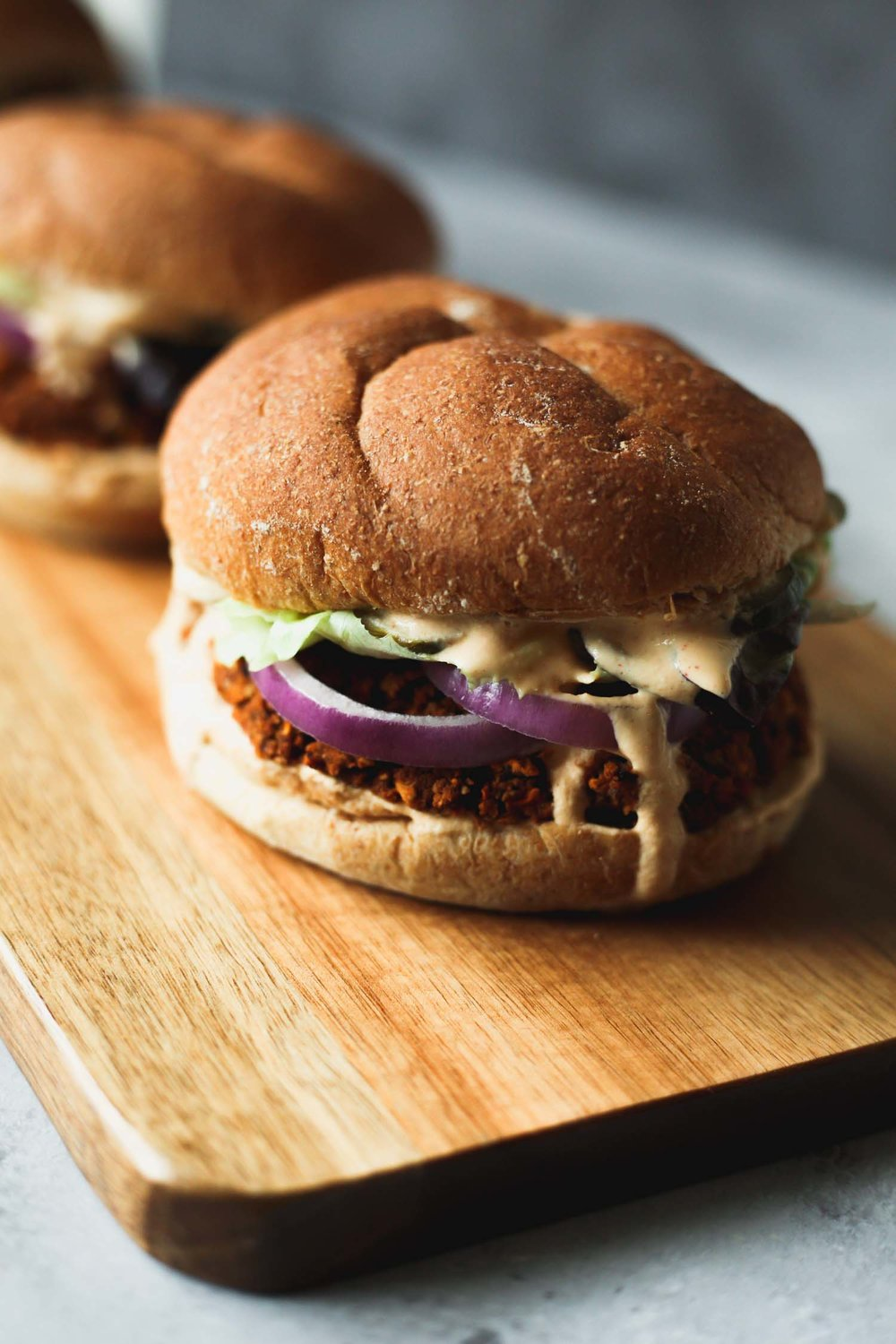 Smoky Tangy cream on Three-Bean Chili Burgers from the cookbook, Vegan Burgers and Burritos by Sophia DeSantis. Photo by Kari of Beautiful Ingredient.