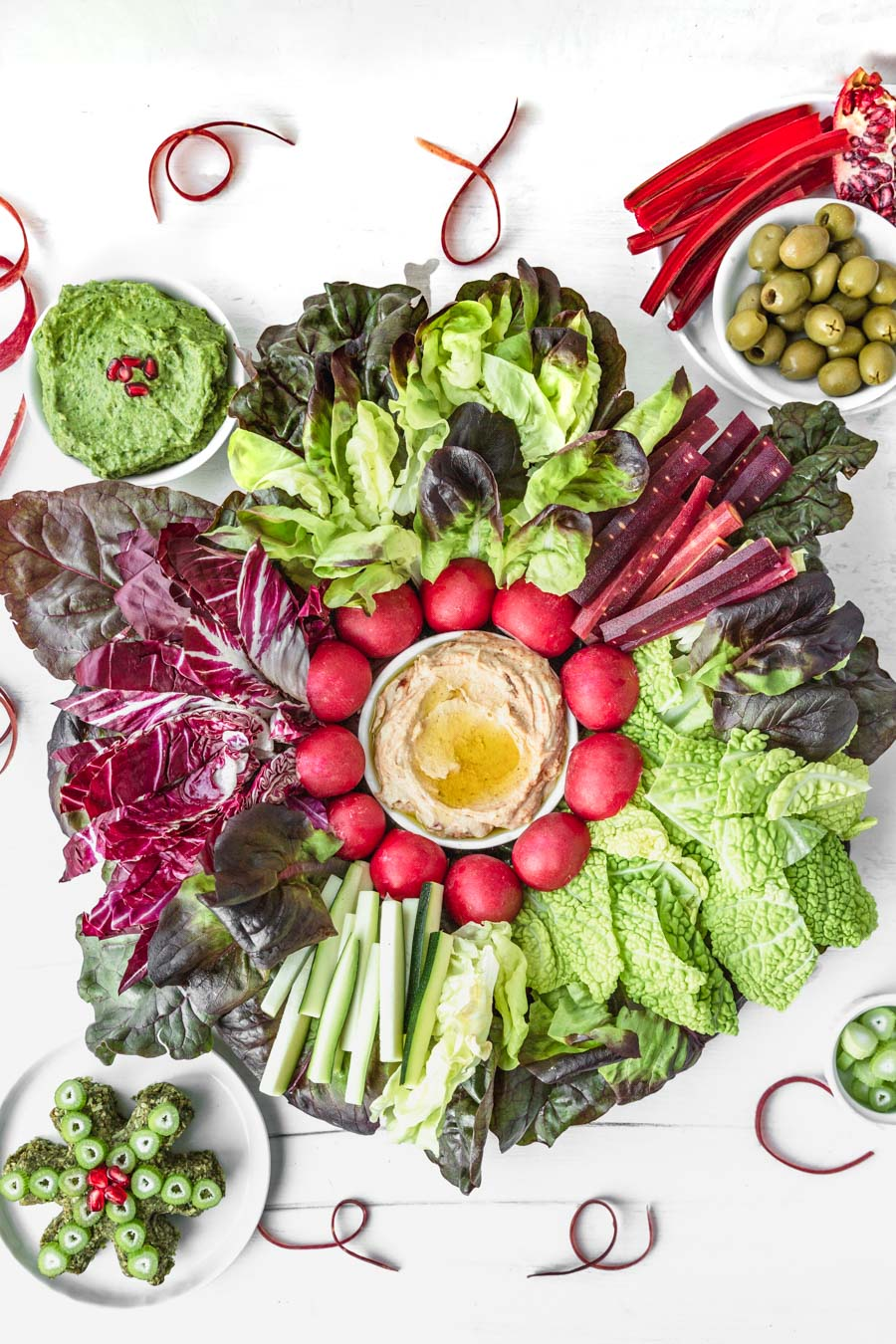 Easy Red & Green Christmas Holiday Veggie Platter with Vegan Arugula-Pecan Cheesy Spread, Power Greens Guacamole, and Hummus. Recipes and photo by Kari of Beautiful Ingredient. #vegan #plantbased #crudite #veggieplatter #redandgreen #christmas #holiday #appetizer #veggies #cheeseboard #partytray