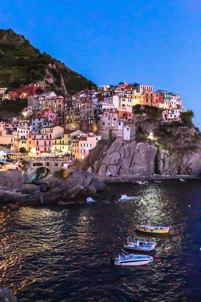 Manarola, Cinque Terre, Italy at blue hour. Photo by Kari | Beautiful Ingredient.