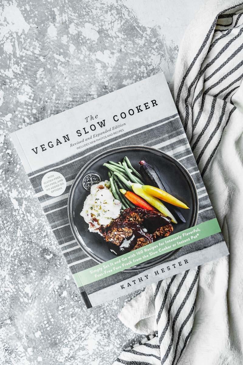 Curried Roast Cauliflower from The Vegan Slow Cooker Cookbook, Revised and Expanded Edition, by Kathy Hester. Photo by Kari of Beautiful Ingredient. #cauliflower #vegancookbook #crockpotrecipe #curry #vegandinner #friedrice #glutenfree #kathyhester #maindish #plantbased #slowcooker #vegan #slowcooker #recipe #roast #curried #sidedish #cookbook