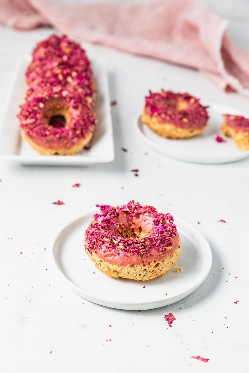 Gluten-Free Vegan Lemon Chia Donuts with Rose Frosting. #glutenfree #glutenfreevegan #vegan #plantbased #veganfrosting #vegandonut #donut #bakeddonut #lemondonut #tigernutflour #refinedsugarfree #oilfree #easyrecipe #donutrecipe #rosefrosting #purplesweetpotato #lemonchia