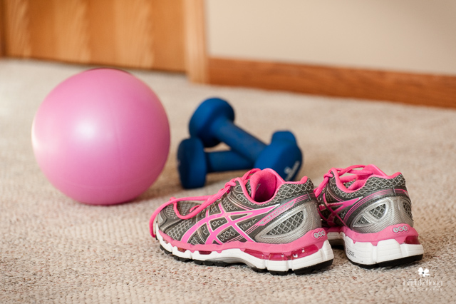 tennis shoes, hand weights and exercise ball