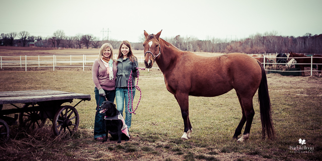 Mother and daughter with their horse and dog