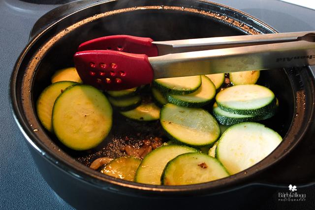 Sauteing zucchini, shallots and garlic