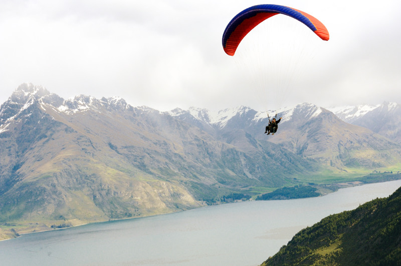 My husband tandem parasailing in Queenstown, NZ