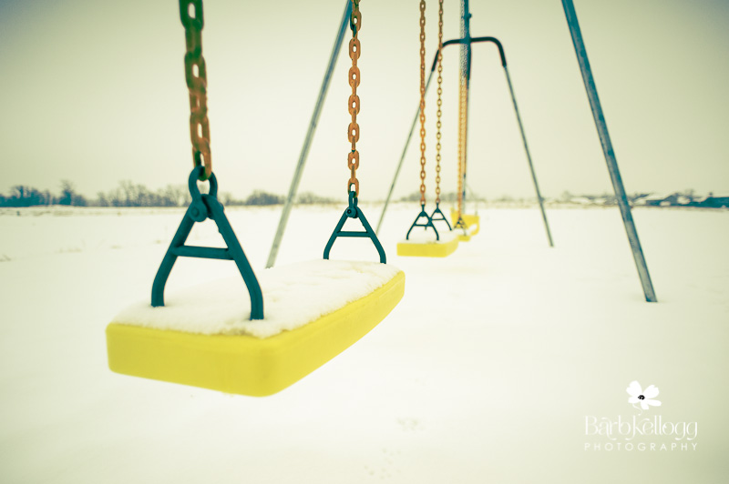 swingset with snow