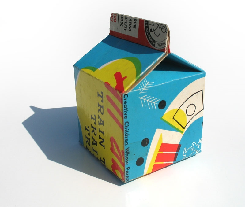 For these little milk carton sculptures I used old record album covers.  Taking something that was designed to be viewed flat and folding it into a 3 dimensional object resulted in some fun crops and surprising graphics.  The half pint milk carton has such great geometry!