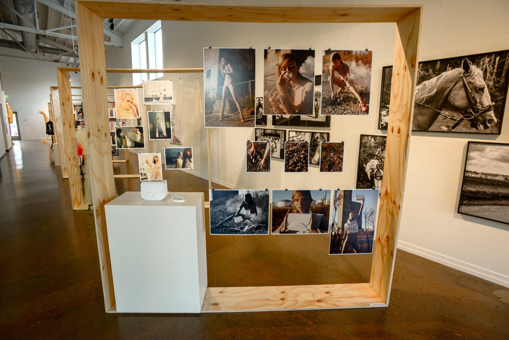 Photos and bag on display at Fashion Happening Nashville