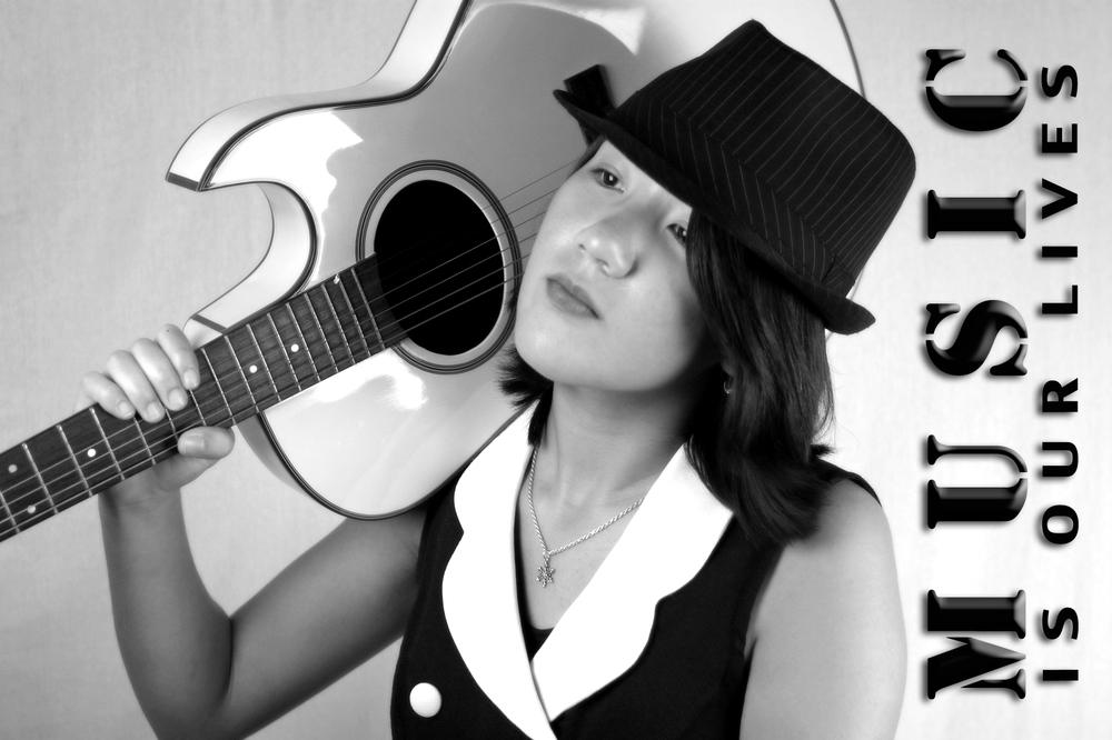 zara with guitar music.jpg