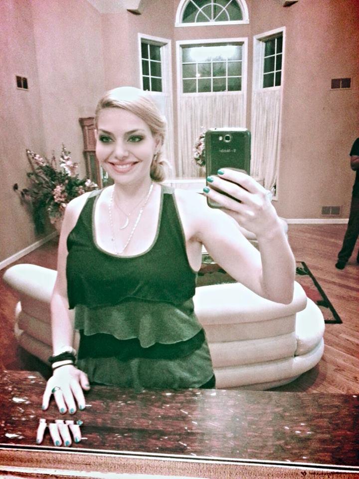 Actress Janet Miranda taking a selfie.