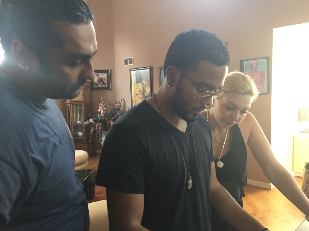 Stunt Coordinator Alim H. Ali, Assistant Director Christian Reyes and Actress Janet Miranda going over the storyboard.