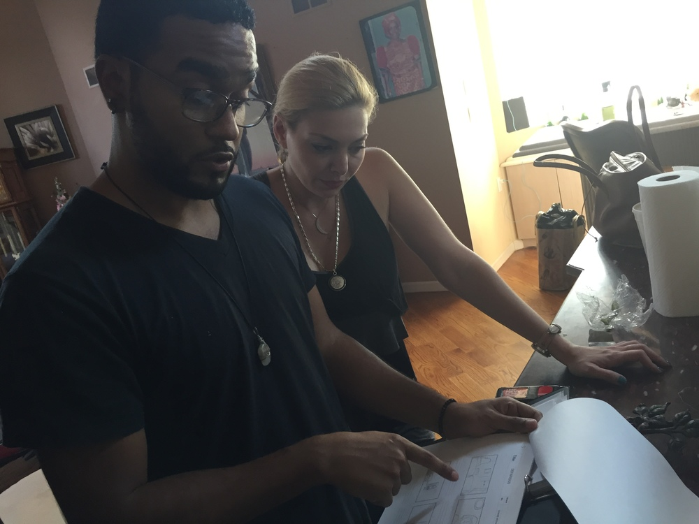 Assistant Director Christian Reyes and Actress Janet Miranda reading through the storyboard.