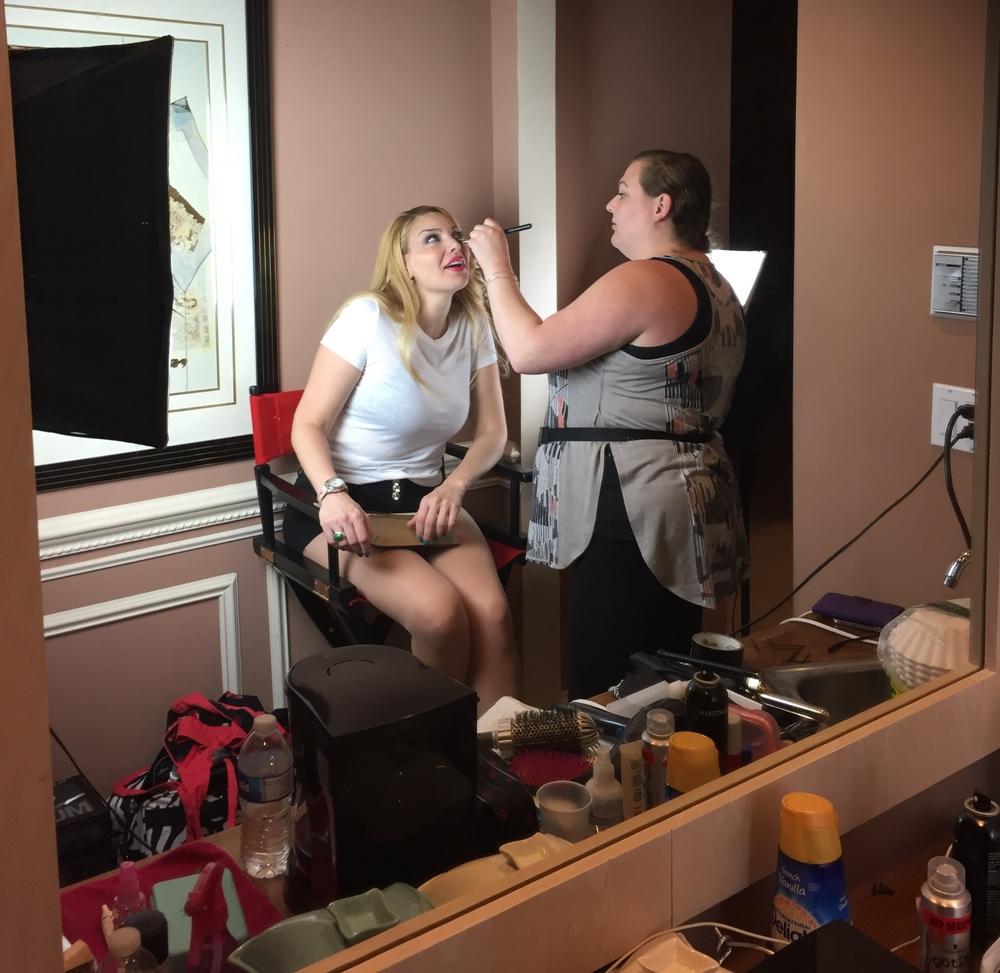 Makeup Artist Sara Ritmiller applying touch ups between takes to Actress Janet Miranda.