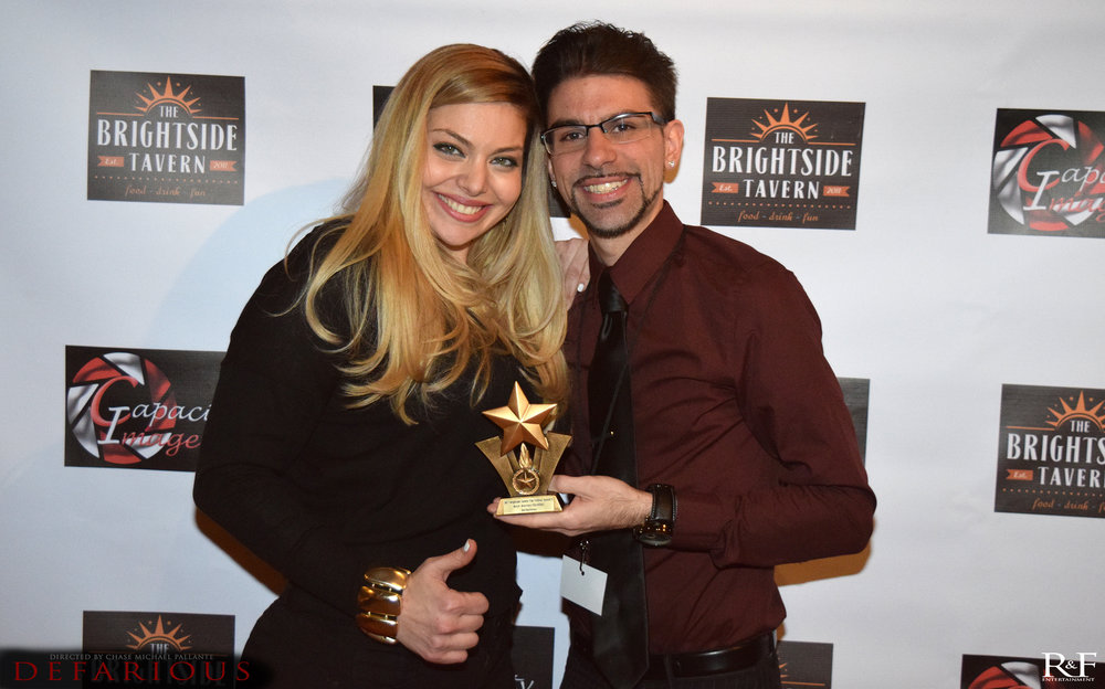 janet and chase with award 2.jpg