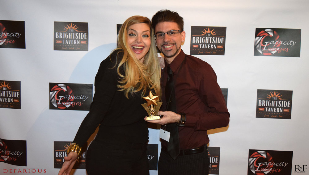 janet and chase with award.jpg