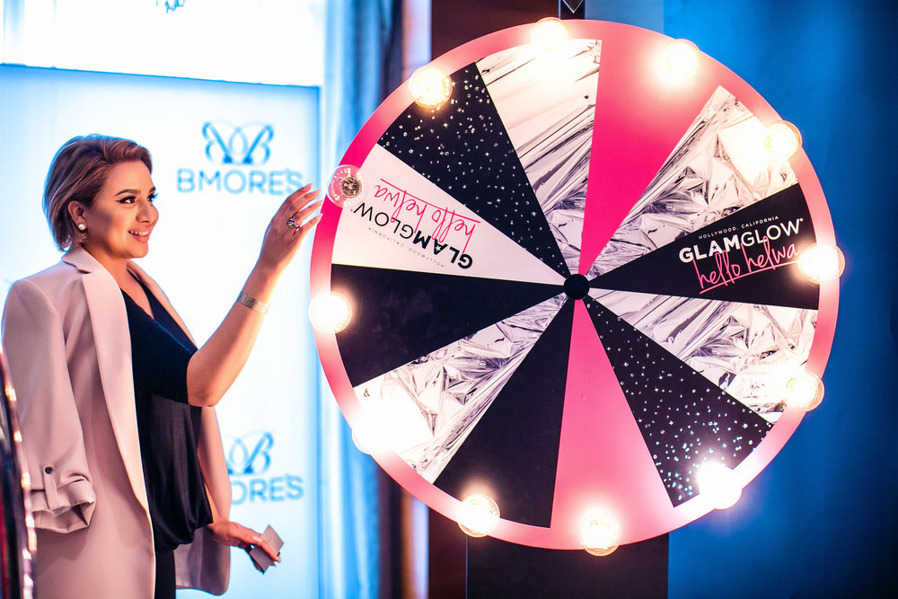 Speaker Nina Ubhi spinning the GLAMGLOW Wheel!