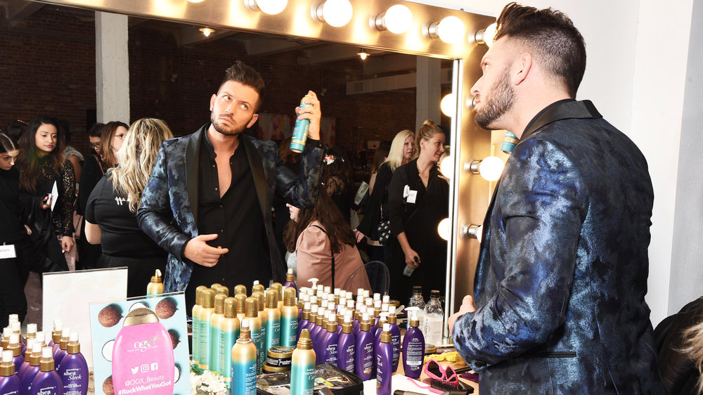 Celebrity stylist  Daniel Musto  testing out  OGX Beauty's  latest products