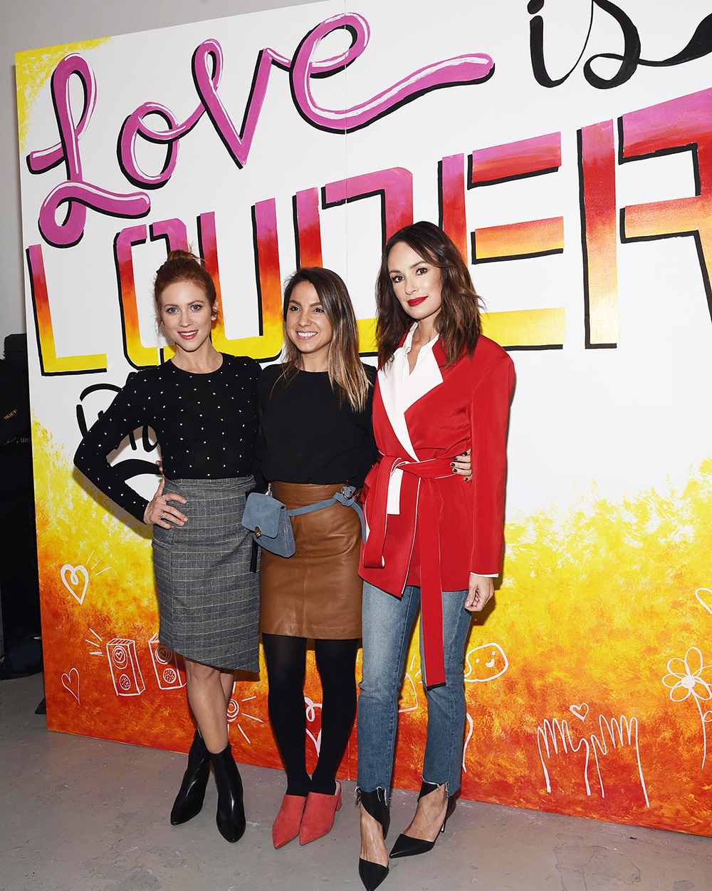 Brittany Snow , SIMPLY founder  Sarah Boyd , and  Catt Sadler  at the  Love Is Louder  art wall