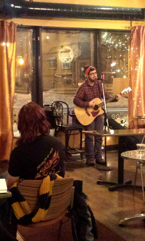 Me, performing at the Spilled Milk Open Mic at the Corner House.