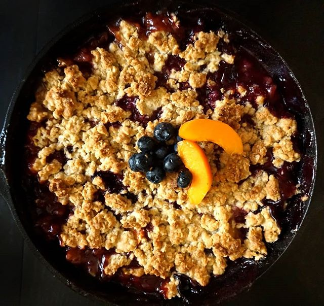 Practicing cobbler season with a Peach, Apricot and Blueberry Bourbon Cobbler.  Didn't have all the ingredients I wanted on hand, but I sure did have a bunch of ripening fruits ready to go!  Didn't turn out too bad. I'm in a mission to make a better one. BTW the blueberries and peaches are unseasonably and GORGEOUS right now.  #sandc #seasonal #summer #cobbler #peach #blueberry #sonya6000 #foodography #castiron #sweets #butnotthatsweet #dessert #simplerecipe #food #love