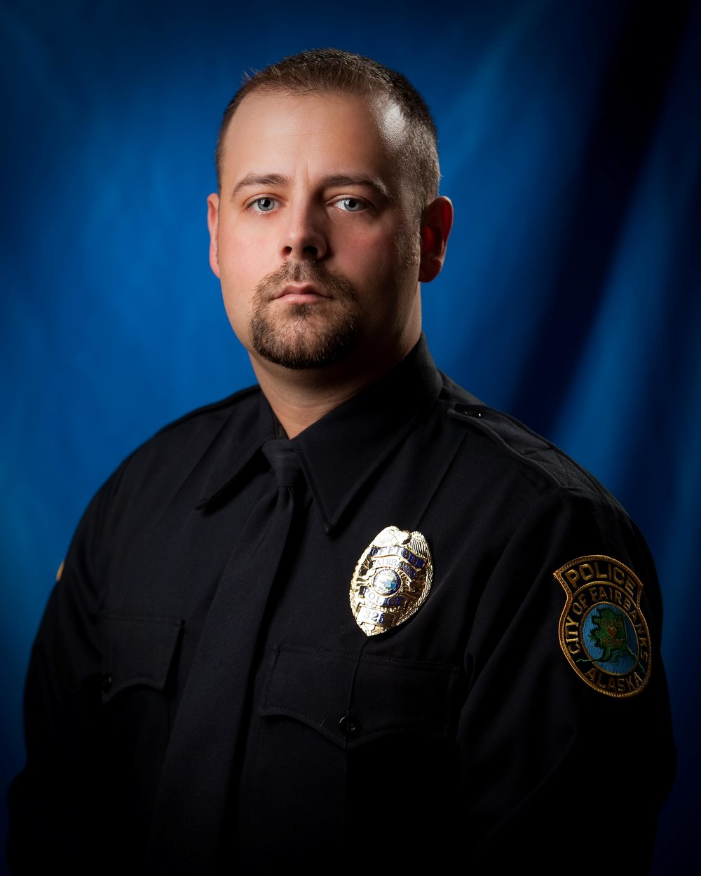 "Officer Robert Hall    City of Fairbanks Police Department    Robert Hall has been a Fairbanks Police Officer since 2009. Prior to coming to work for the City of Fairbanks, Officer Hall was a Correctional Officer from 2006-2009.  He also served our country as a Security Forces member in the Alaska Air National Guard from 2000-2012. Officer Hall is a K-9 handler and has been with his trusted partner, ""Stryker"" since 2013. Officer Hall and Stryker make a great team and consistently train in drug detection, tracking of suspects, building searches, warrant services, and public/educational demonstrations. Hall is called in his off duty time throughout the year by FPD and other surrounding law enforcement agencies to assist due to his K-9 experience.  He also makes appearances at local events throughout the year such as Mush for Kids, Youth Day, and the Midnight Sun Street Fair. Since 2010, he has acted as the Interior point of contact for the Special Olympics Law Enforcement Torch Run. This has entailed working with the State of Alaska Special Olympics on coordinating the run and law enforcement volunteers, which has raised an average of $8,000 a year.  Robert spent 2014 as the assistant coach for Special Olympics track and was the head coach in 2015 before passing the torch. He has also helped put on the Law Enforcement Torch Run ""Tip a Cop"" dinner."