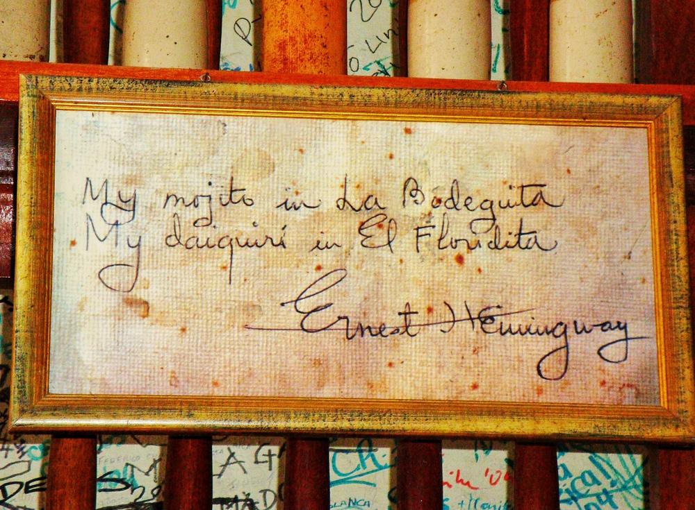 Hemingway's original autograph hanging on a wall in El Bodeguita del Medio